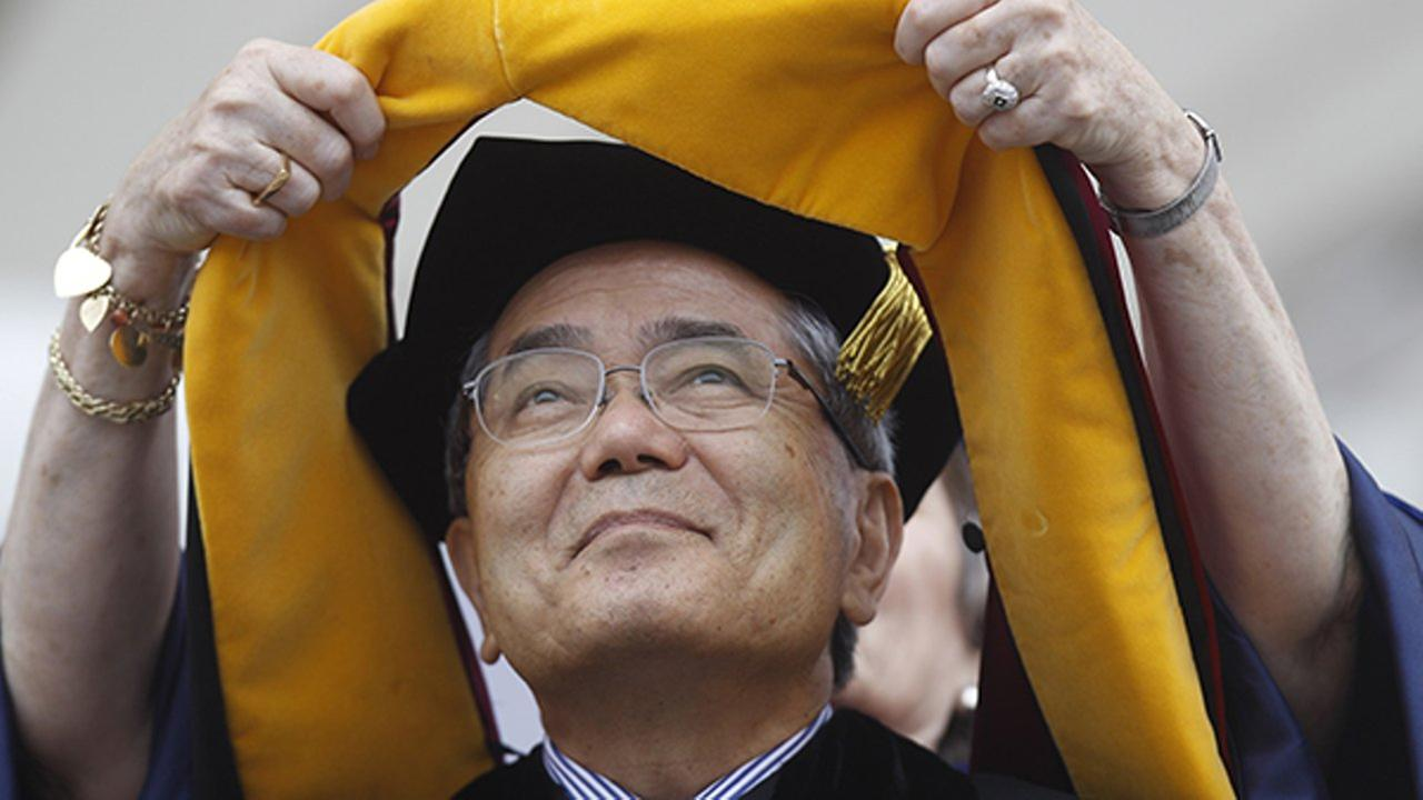 FILE - In this May 16, 2011 file photo, Nobel Prize winning chemistry professor Ei-ichi Negishi, of Japan, receives an honorary degree at the University of Pennsylvania.