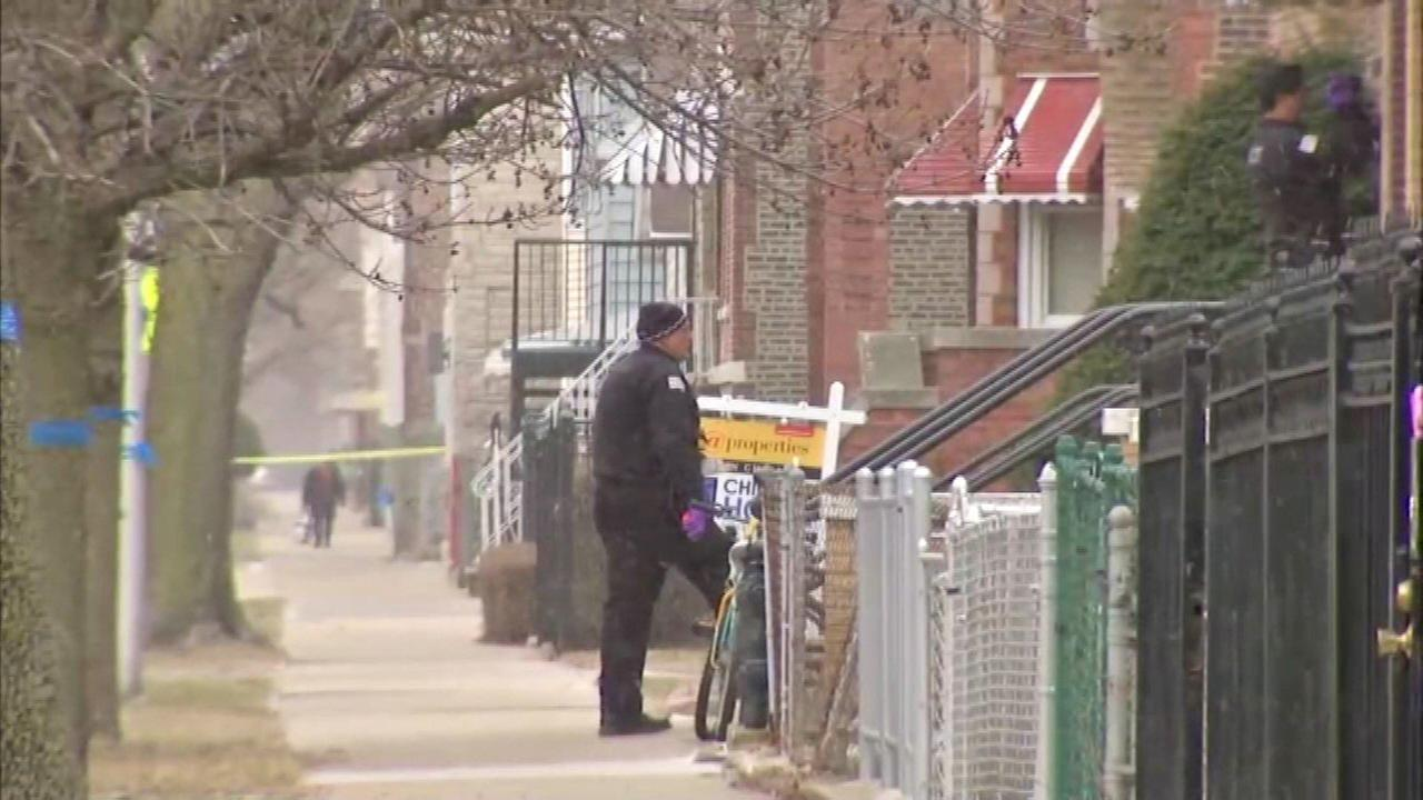 Police investigate after an officer shot a man in the 2800-block of South Throop Tuesday.