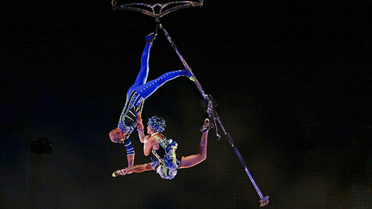 FILE: In this April 18, 2016 photo, aerial artists perform in a new act at the Cirque du Soleil show at Disney Springs, in Lake Buena Vista, Fla.