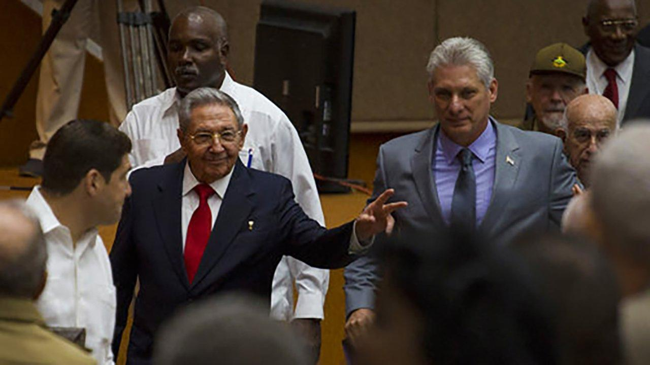 In this photo released by Cubas state-run media Cubadebate, Cubas President Raul Castro, center left, enters the National Assembly followed by Miguel Diaz-Canel, center right.