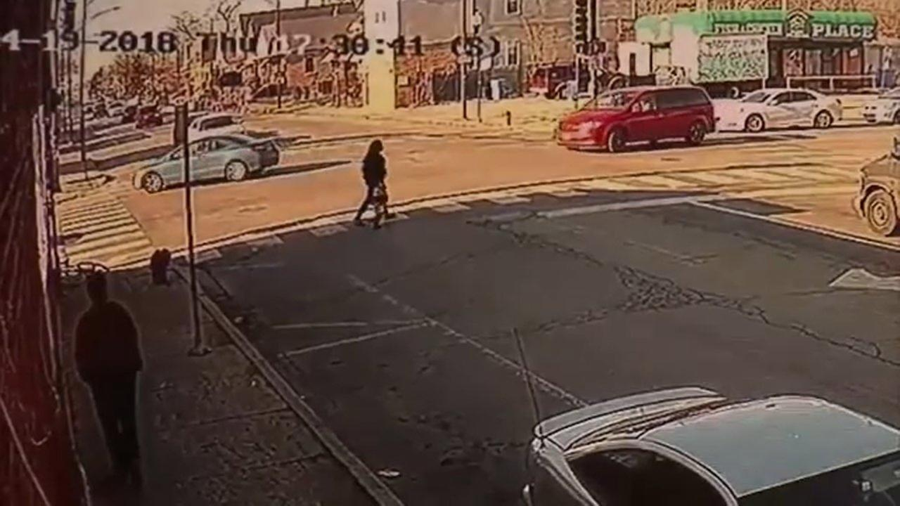 A surveillance image showing a 3-year-old boy and a woman before they were struck by a minivan at 71st Street and Damen Avenue Thursday.