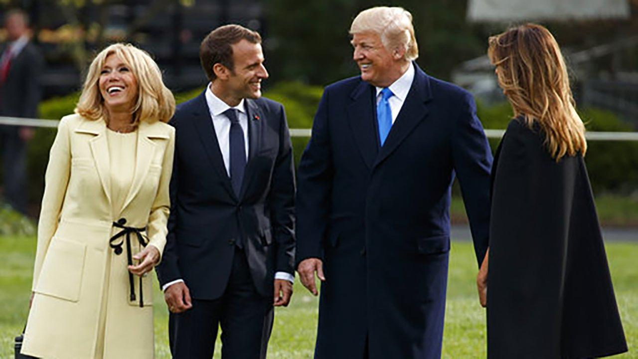 President Donald Trump and first lady Melania Trump talk with French President Emmanuel Macron and his wife Brigitte Macron at the White House on Monday, April 23, 2018.