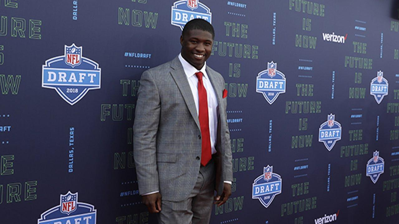 Georgias Roquan Smith poses on the red carpet before the first round of the 2018 NFL football draft, Thursday, April 26, 2018, in Arlington, Texas.