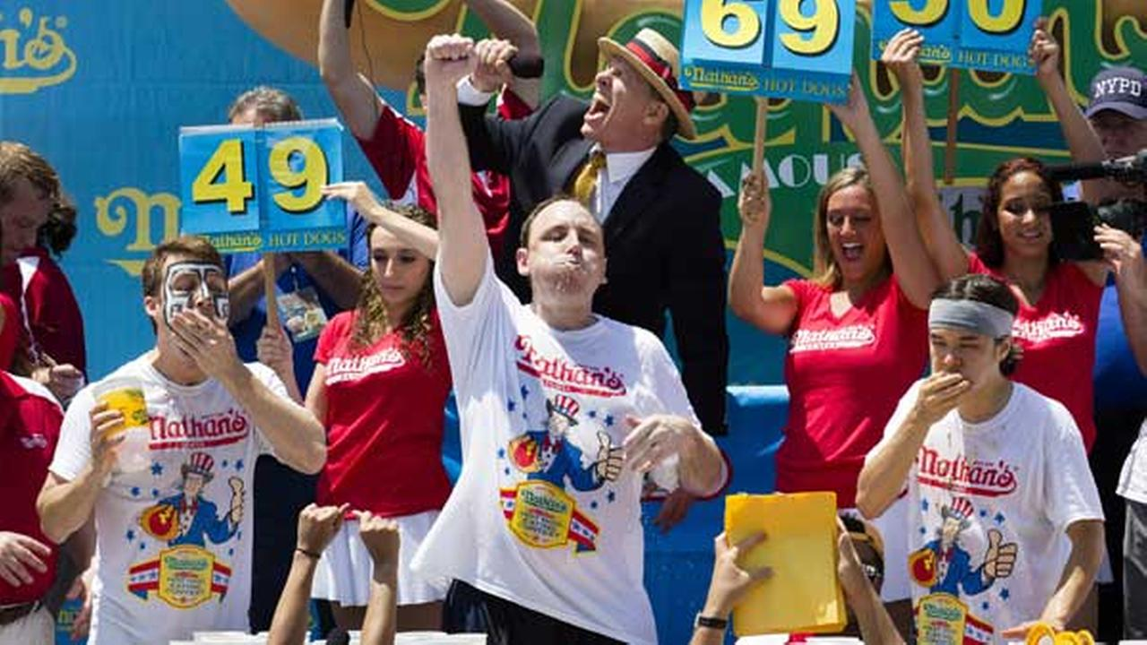 Joey Chestnut, center, wins the Nathans Famous Fourth of July International Hot Dog Eating contest with a total of 69 hot dogs and buns at Coney Island.