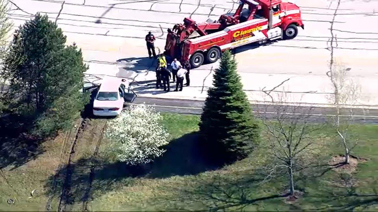 A 95-year-old Downers Grove woman died after her car went into a retention pond near DuPage Parkway.