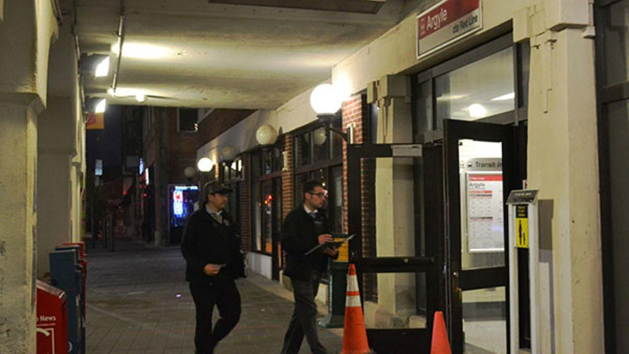 Police investigate the scene where a 25-year-old man was stabbed and robbed while riding on a CTA Red Line train in the 1100-block of West Argyle.