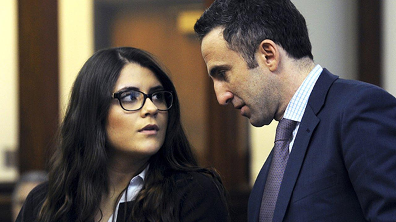 In this March 3, 2017 photo, Nikki Yovino, left, appears with her attorney Mark Sherman as she is arraigned in Bridgeport Superior Court, in Bridgeport, Conn.
