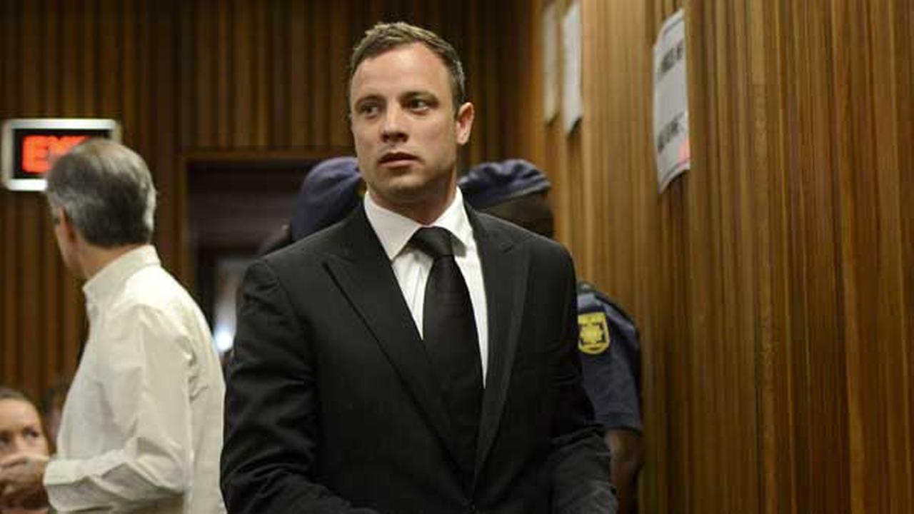 Oscar Pistorius arrives in court in Pretoria, South Africa. Judge Thokozile Masipais announced the Olympic runners sentence for killing girlfriend Reeva Steenkamp.