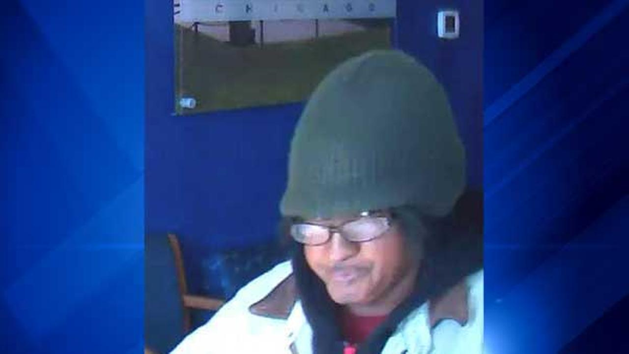 Surveillance photo of female suspect in robbery of Chase Bank branch in 4400-block of West North Avenue.