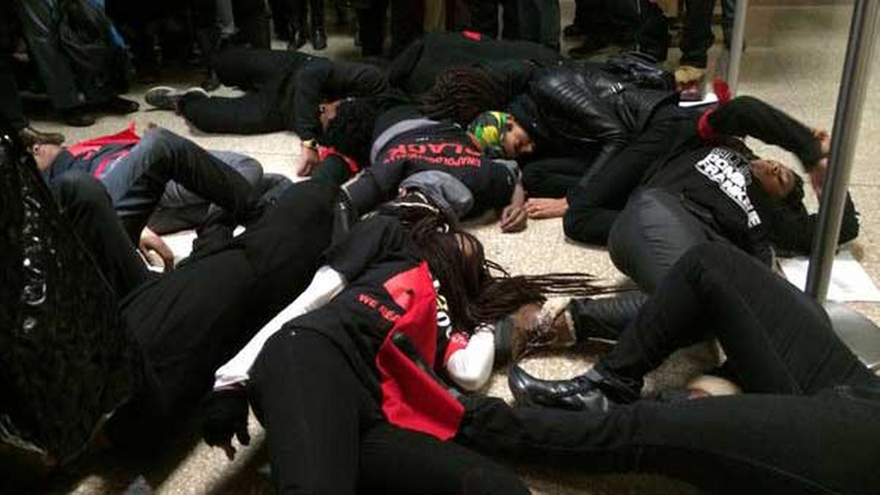 Members of The Black Youth Project, one of the groups leading the local protests against the Ferguson decision, staged a sit-in at City Hall.