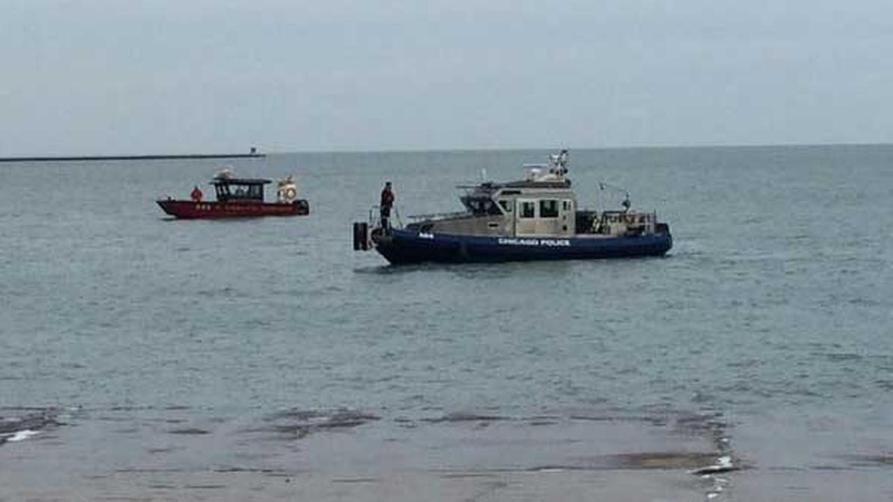 Chicago police and fire boats search for a vehicle submerged in Lake Michigan just off Oak Street Beach.