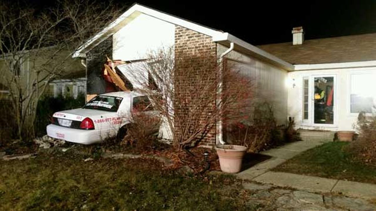 A cab crashed through the side of a home in west suburban Glendale Heights, trapping the homeowner under a wall.