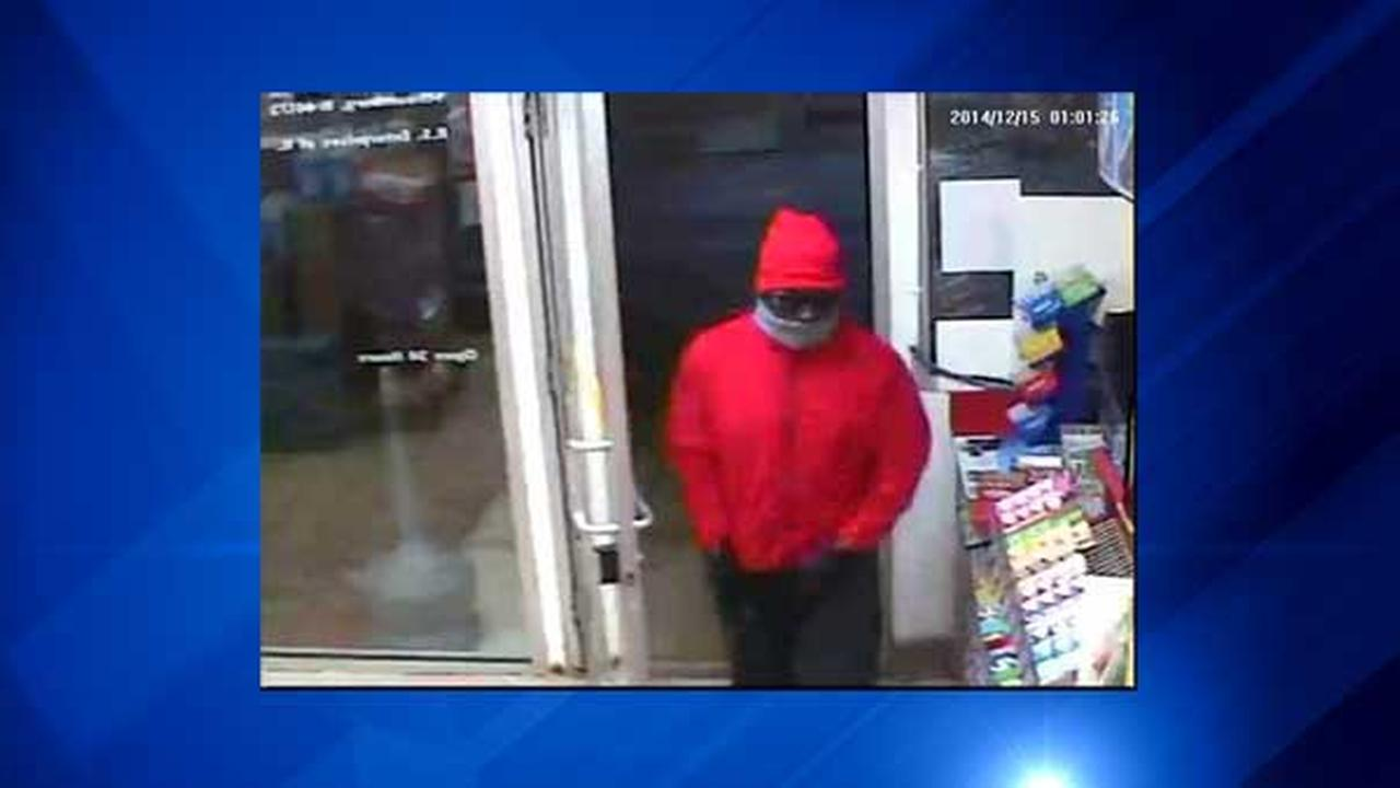 Surveillance image of suspect in armed robbery at northwest suburban gas station.