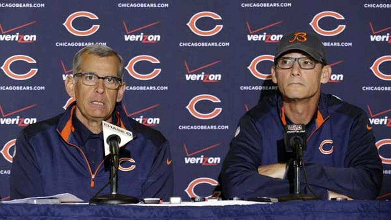 Chicago Bears general manager Phil Emery, left, talks to the media as head coach Marc Trestman listens at a news conference during the teams NFL football training camp.