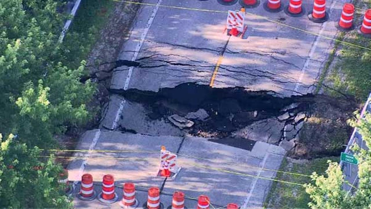 Pavement on Diamond Lake Road in north suburban Long Grove buckled after a pipe collapsed beneath the road.