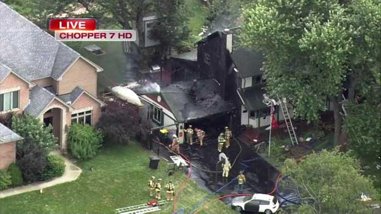 A car caught fire inside a garage attached to a home in West Chicago.
