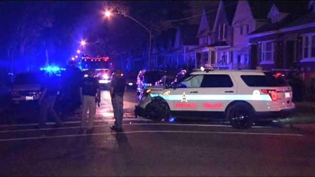 Three people, including two Chicago police officers, were injured in a crash in the citys Englewood neighborhood.
