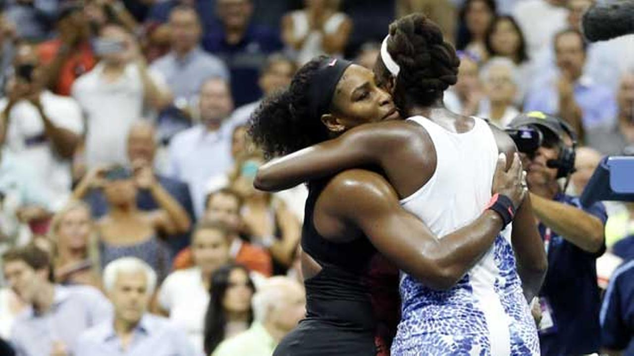 Serena Williams, left, hugs Venus Williams after winning their quarterfinal match at the U.S. Open tennis tournament in New York.AP Photo/Julio Cortez