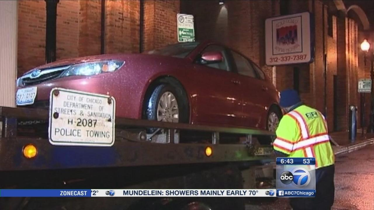 Cars towed after parking ban takes effect
