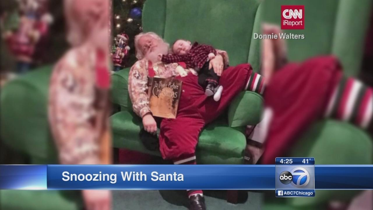 Baby snoozes with santa