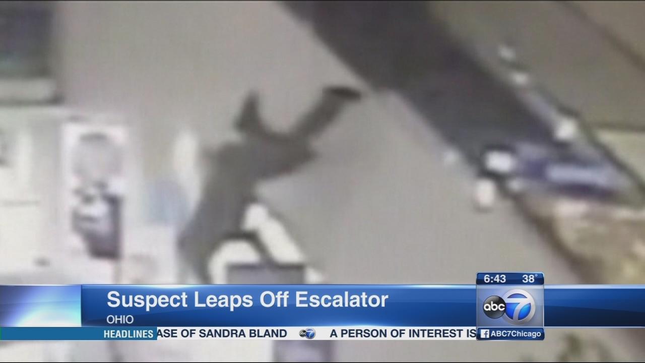 Suspect leaps off escalator