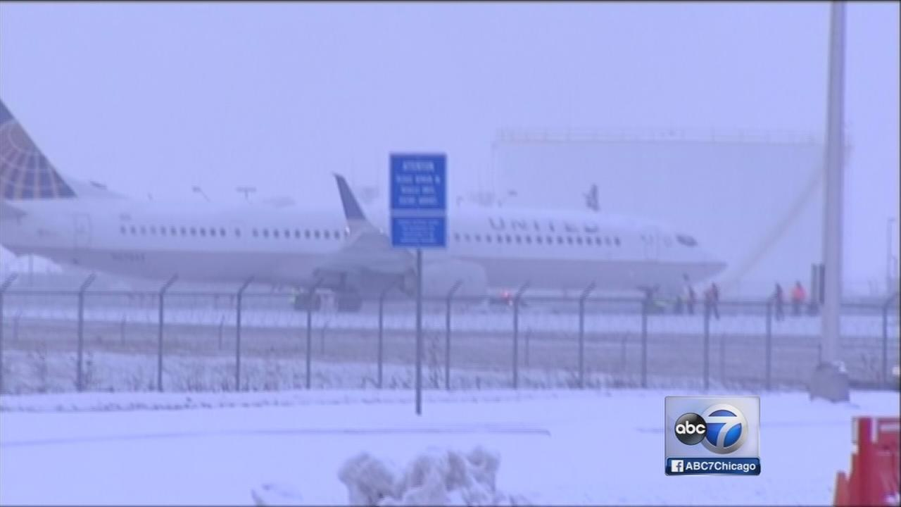 United airlines plane slides off runway at o hare airport