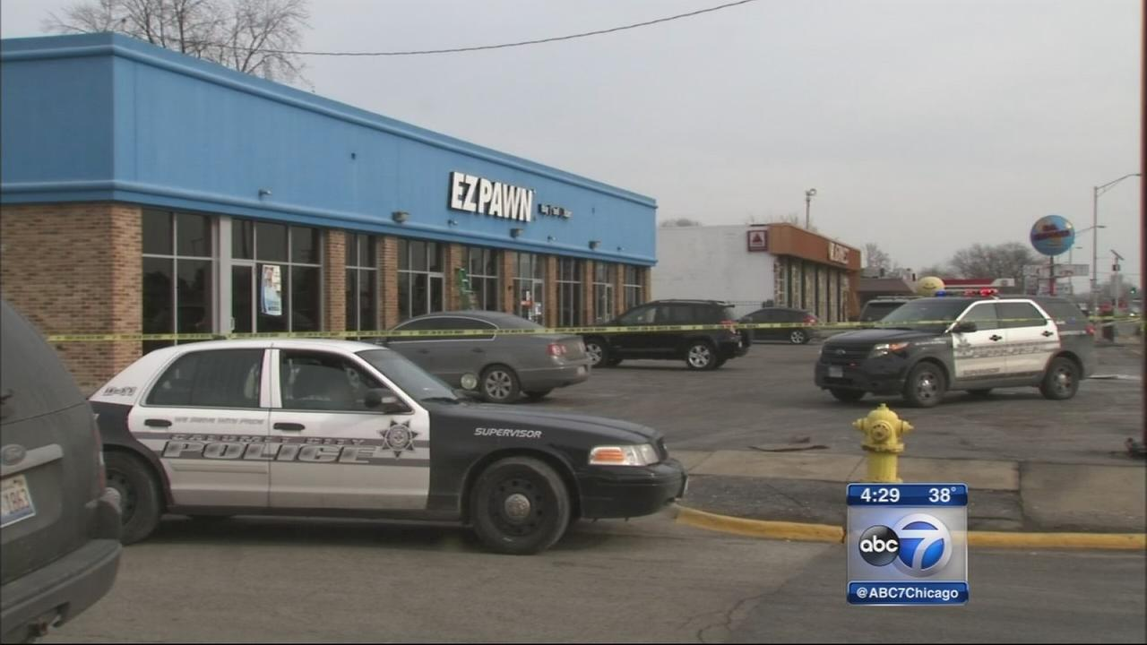 EZ Pawn robbers foiled by customer