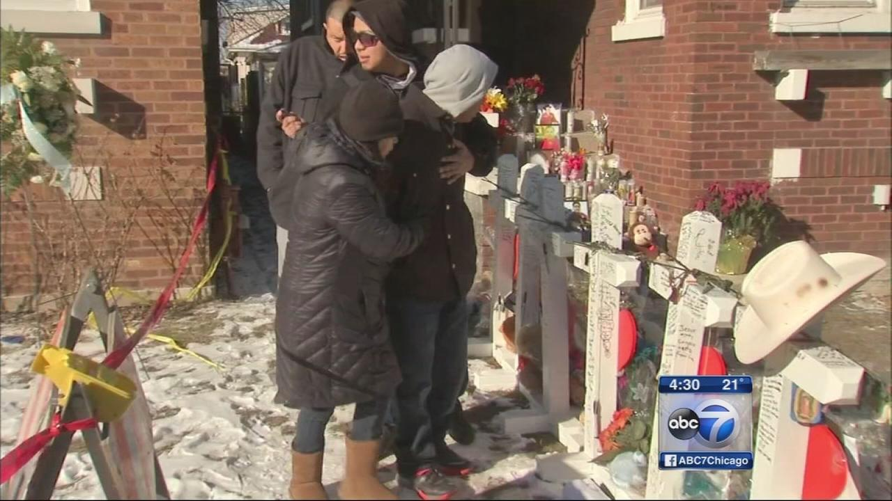 Relatives of murdered Gage Park family enter home