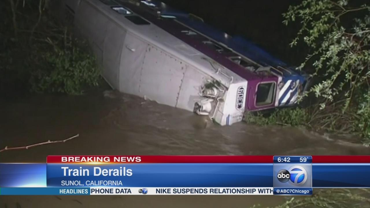 Commuter train derails, car plunges into creek