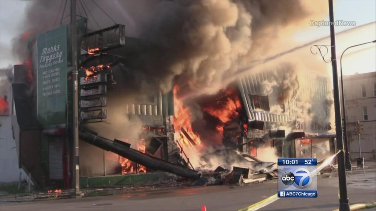 Firefighters battle building fire in Harvey