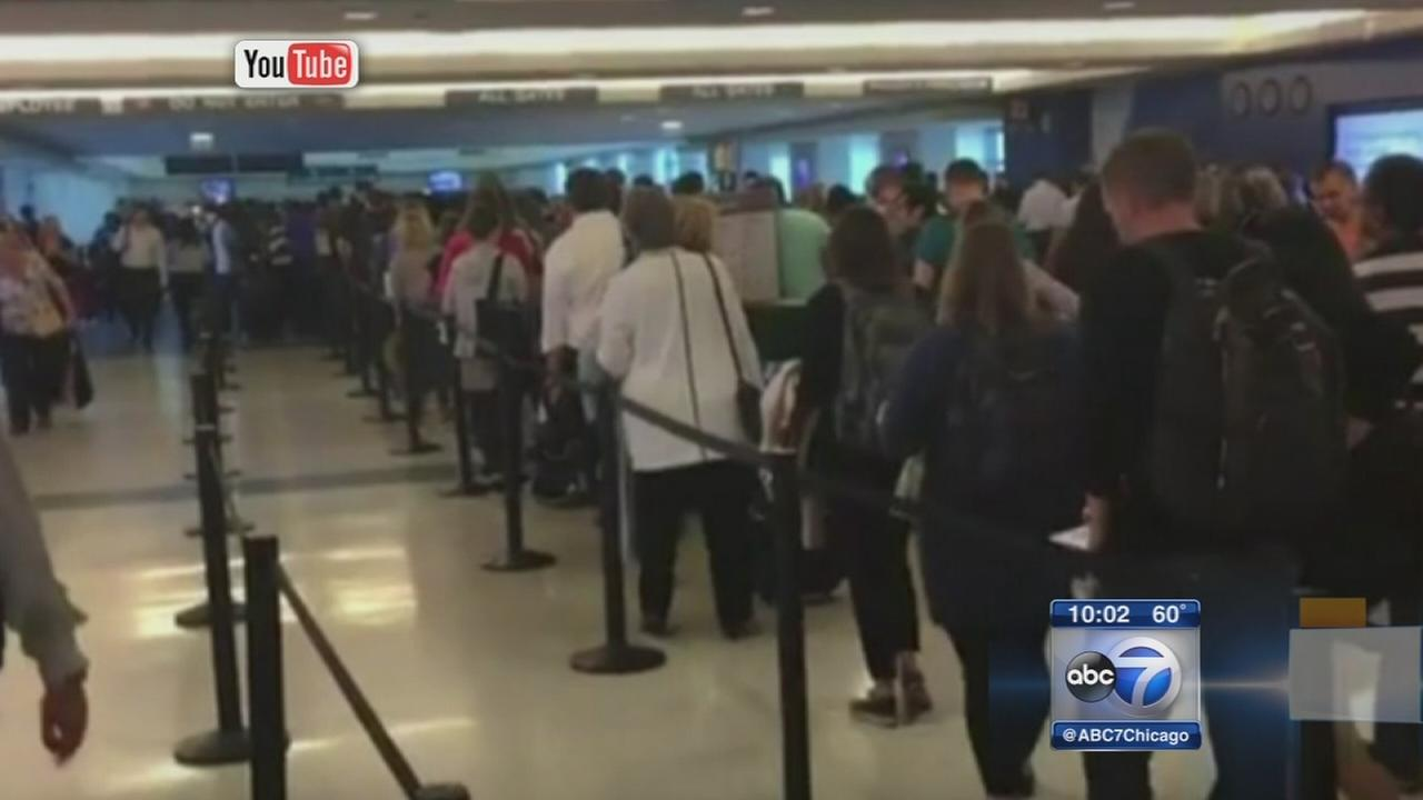 Passengers encounter long security lines at Midway