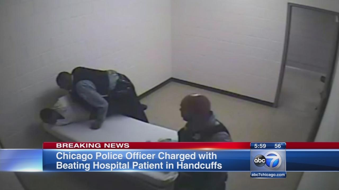 Video shows Chicago cop punching handcuffed man