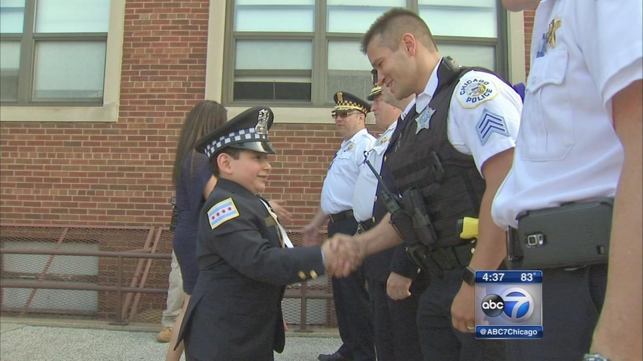 Police, firefighters attend graduation of fallen officers son