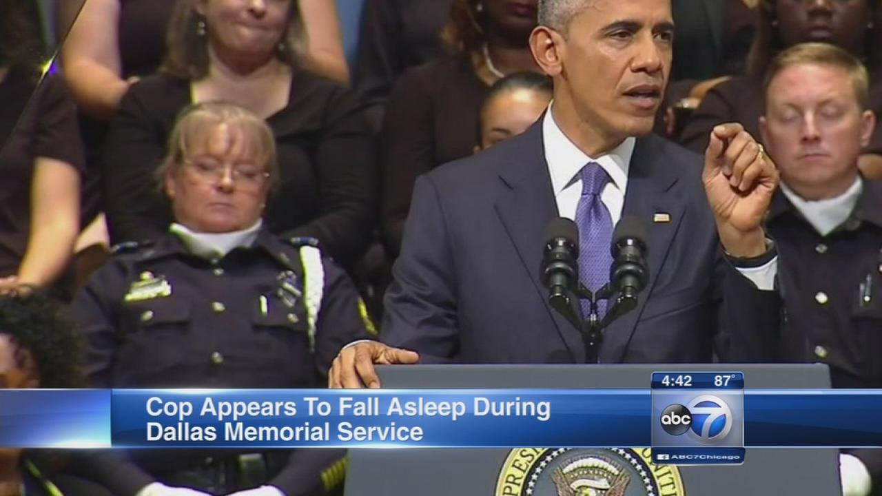 Cop apparently falls asleep during Dallas memorial service
