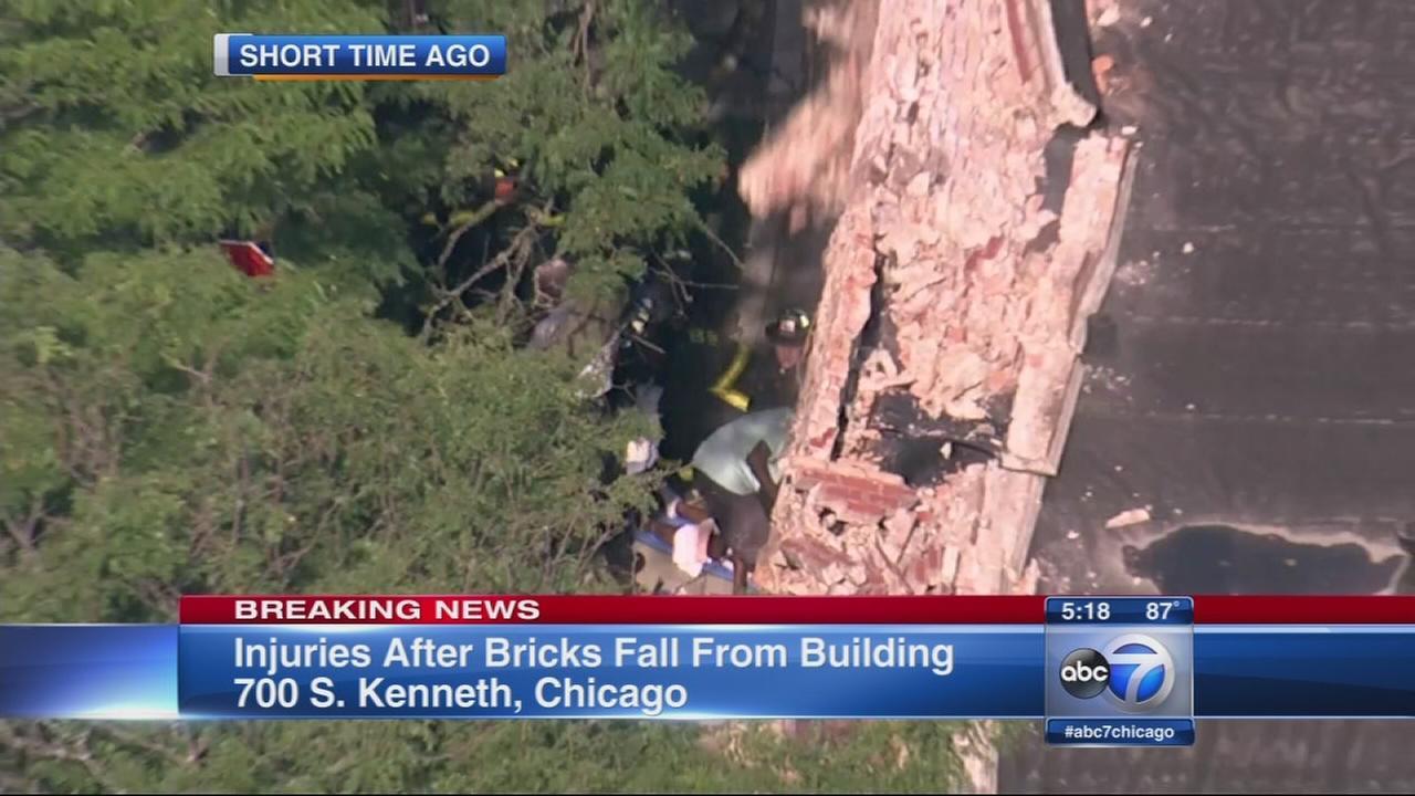 Bricks falling from building injures 2