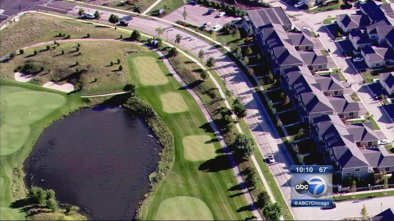 Woman claims she was hit by golf ball while driving near golf course