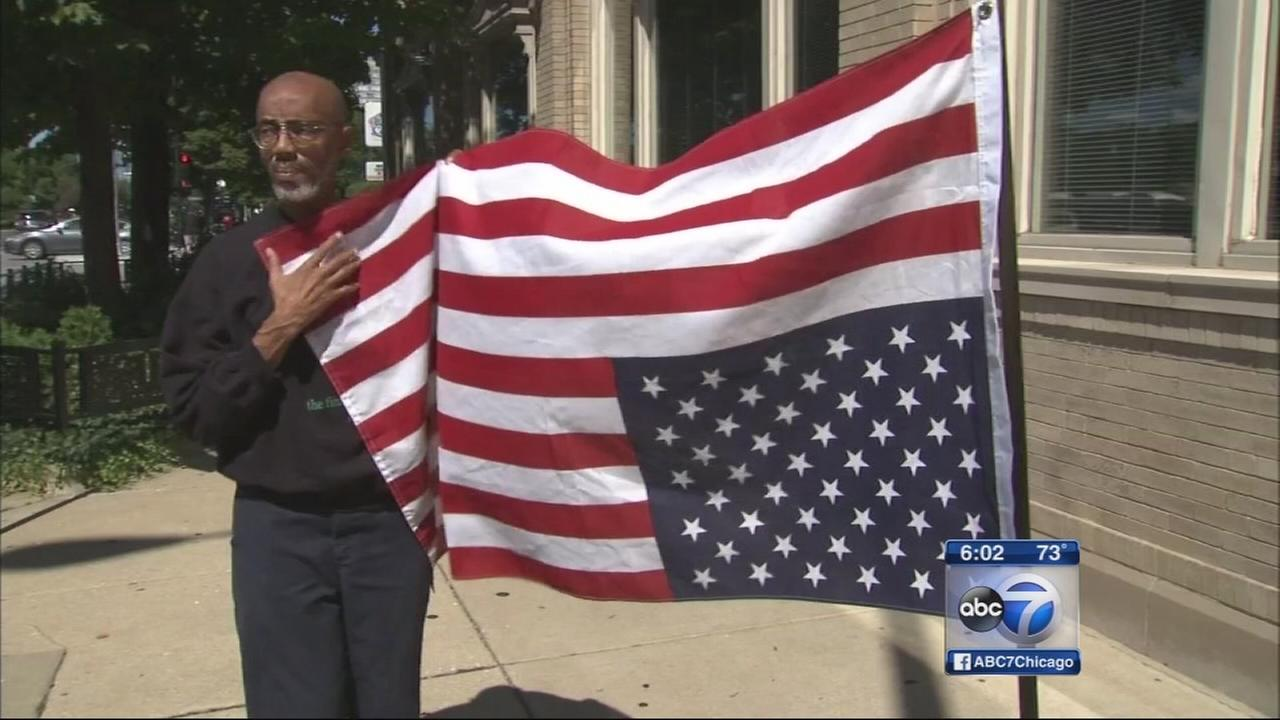 Activists call on Chicagoans to fly flags upsaide down