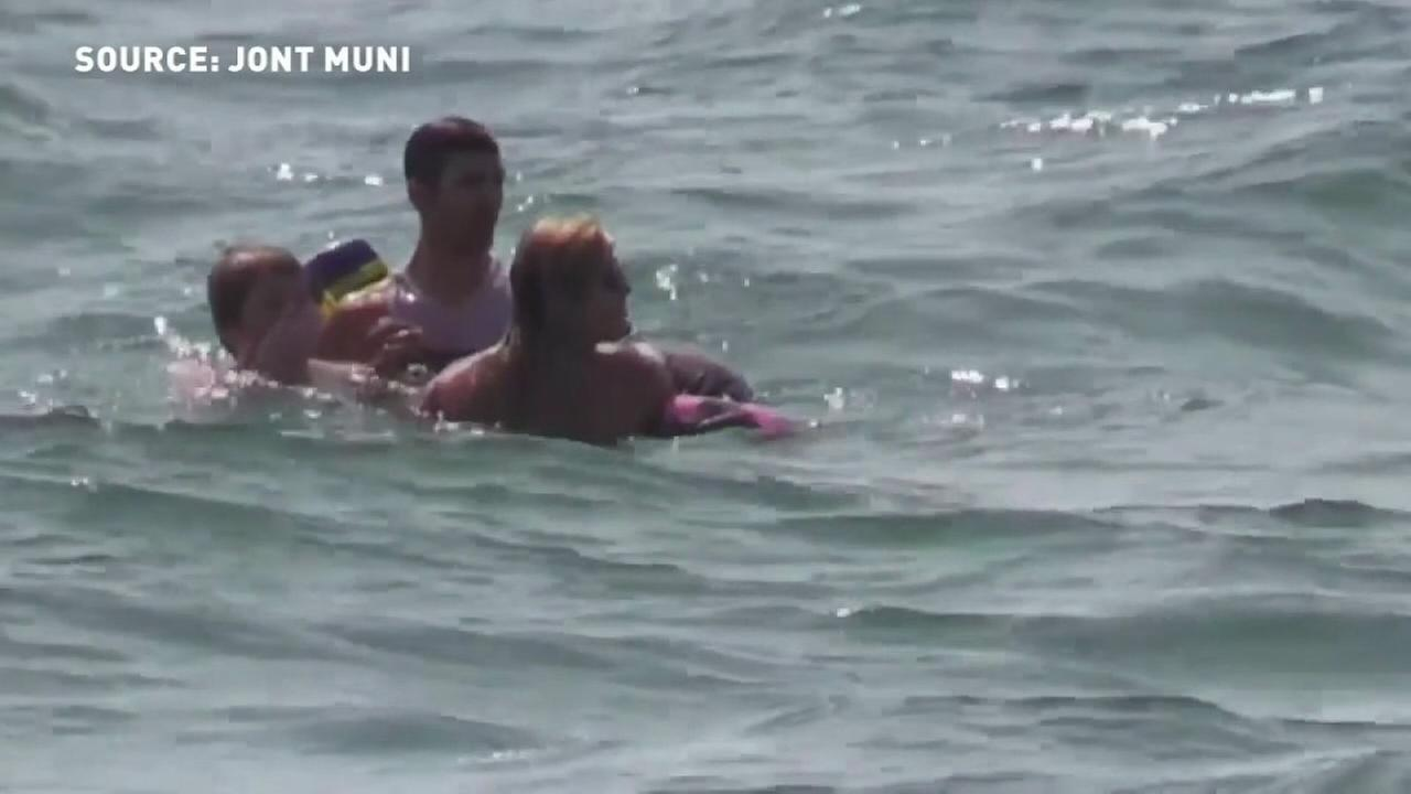 Woman rescues 2 from rip tide