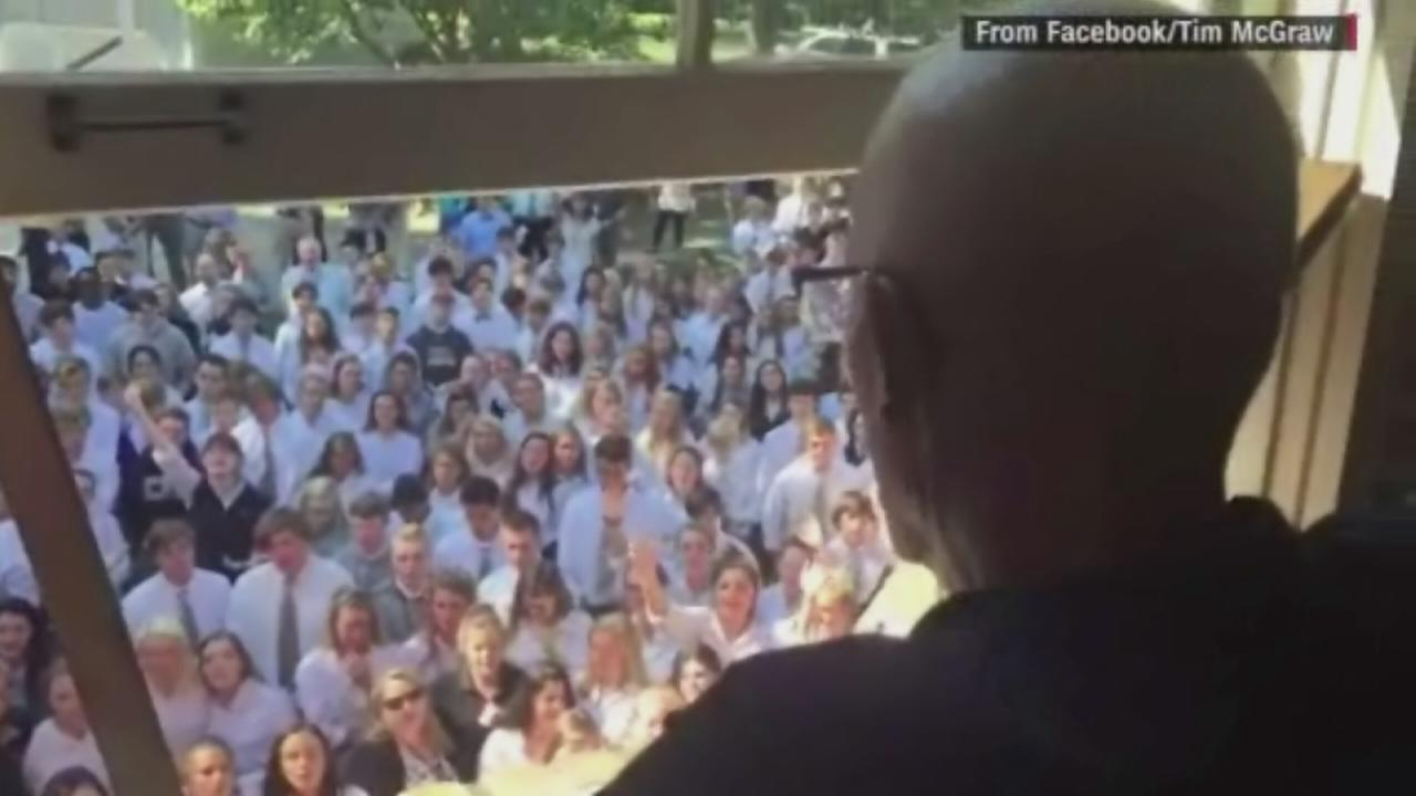 Hundreds of students and faculty members serenade Ben Ellis, a Tennessee high school teacher battling cancer,  on September 7, 2016.