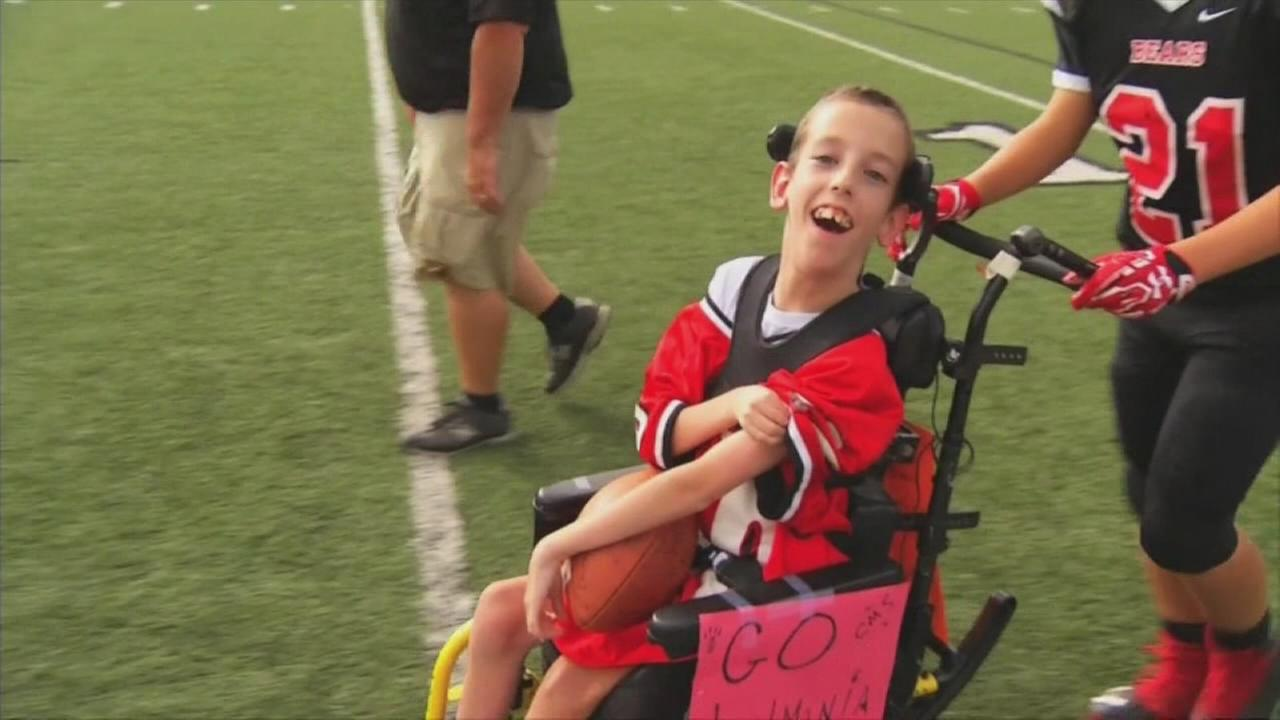 Teams help boy in wheelchair score touchdown