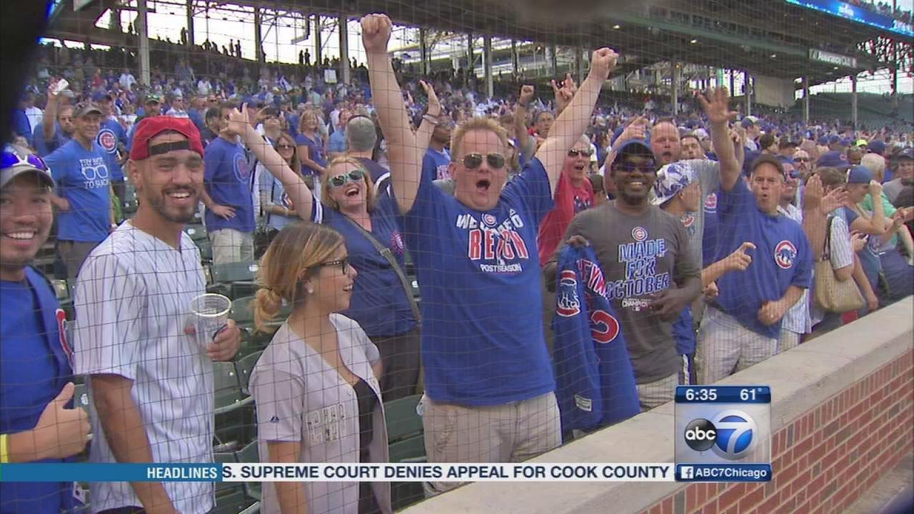 Cubs fans celebrate at Harry Caray