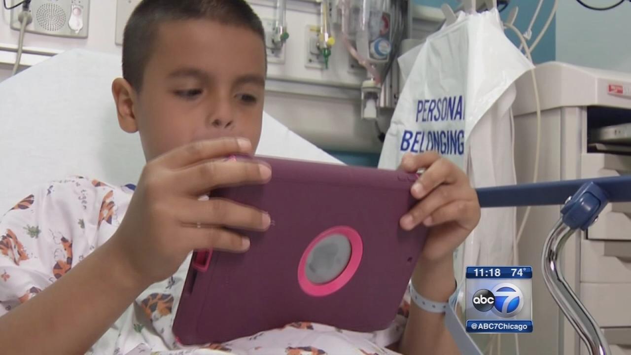 Kids take iPads into surgery