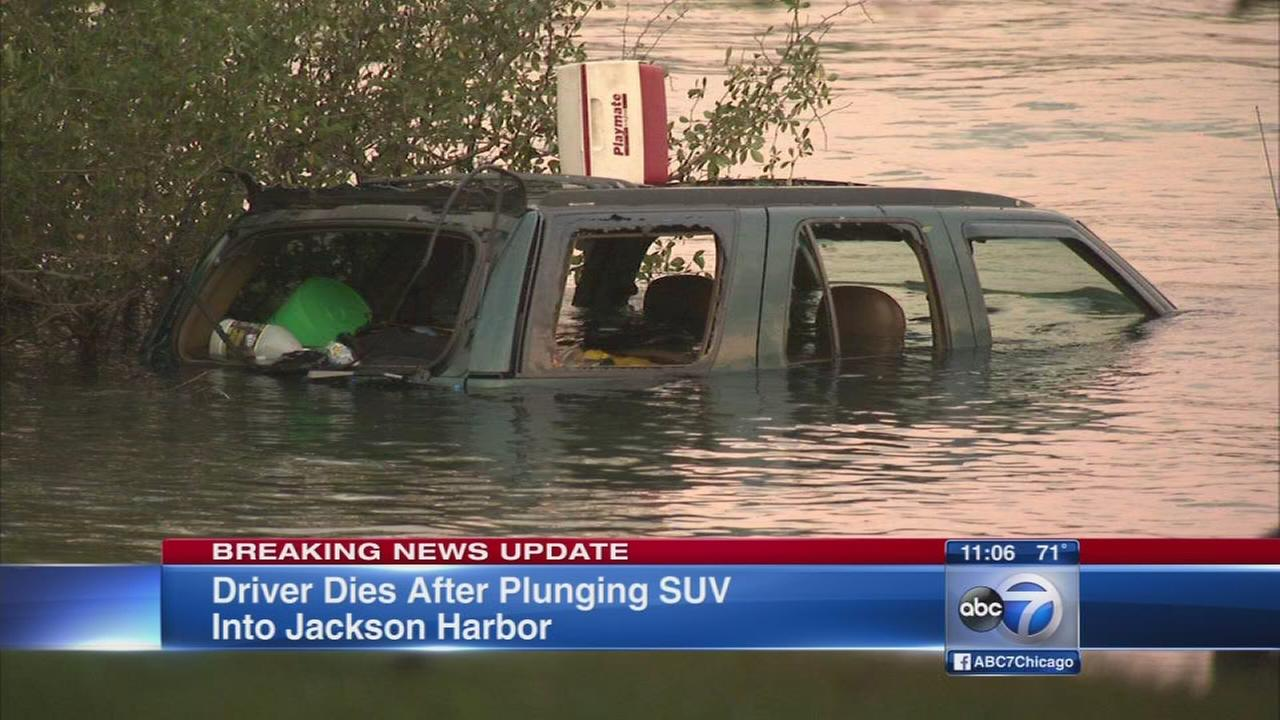 Man pulled from SUV in water dies