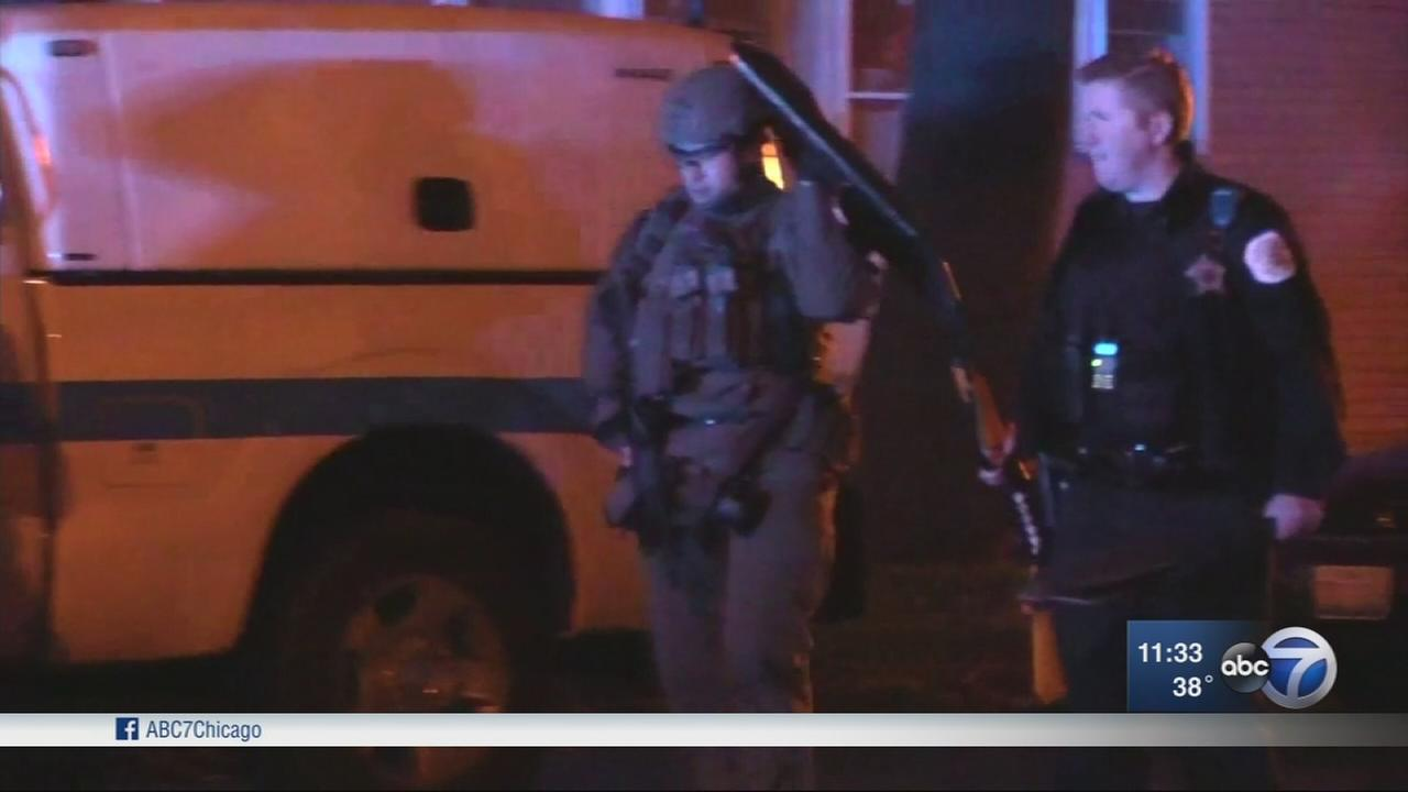 Shots fired at police lead to standoff