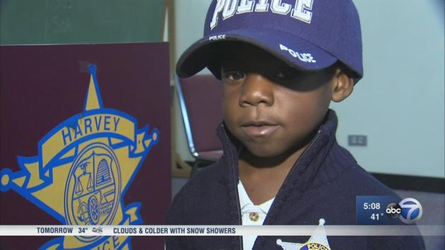 Image result for Slain Security Guard's 5-Year-Old Son Sworn In As Honorary Harvey Cop