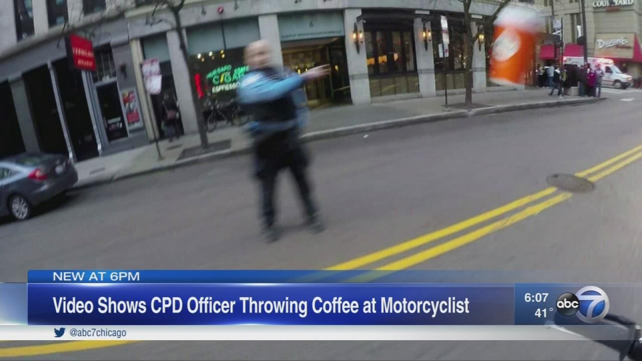 Police investigate video showing officer throwing coffee at biker