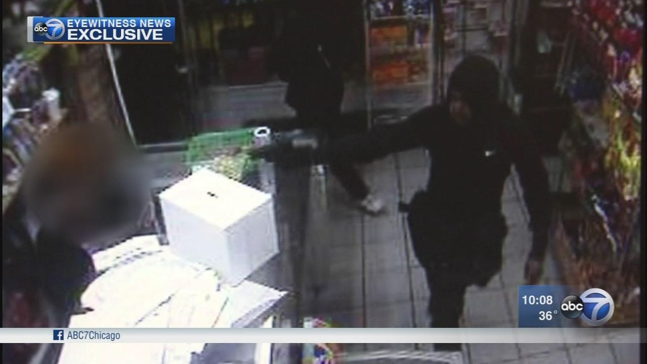 Exclusive video shows armed robbery of family grocery
