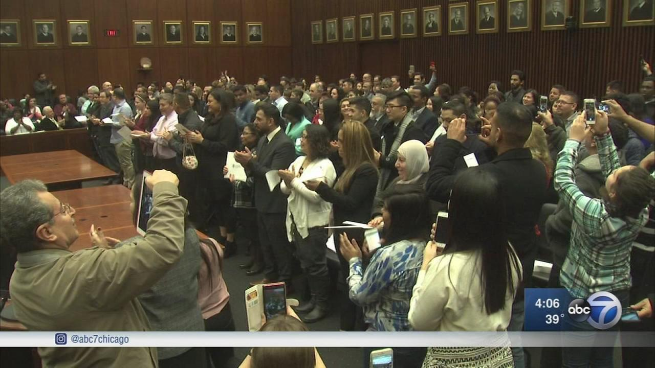 115 become US citizens in Chicago Tuesday