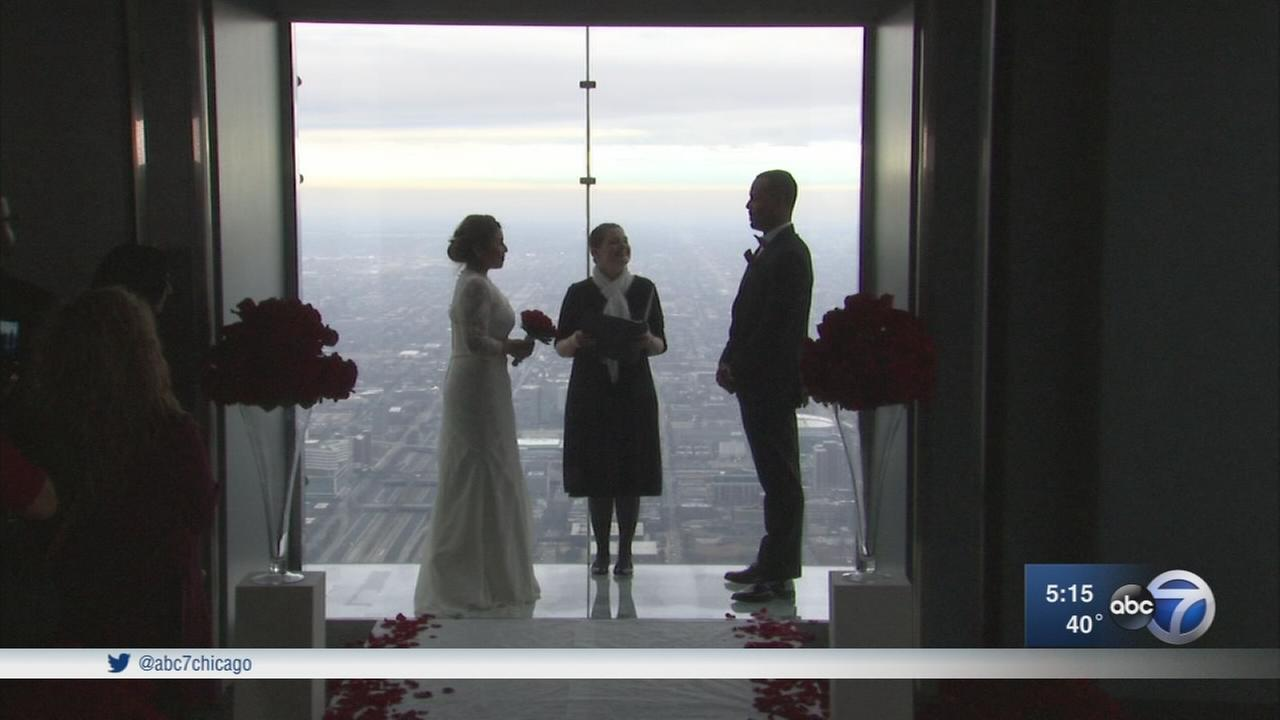Couples marry atop Willis Tower