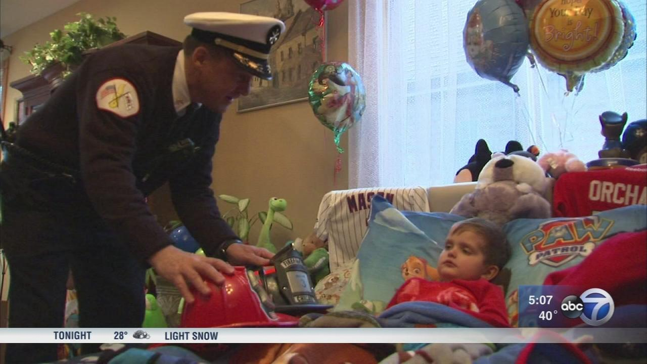Chicago firefighters surprise boy, 4, with terminal cancer